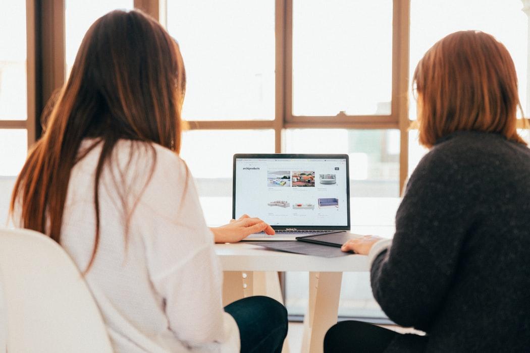 Two people scrolling a website.